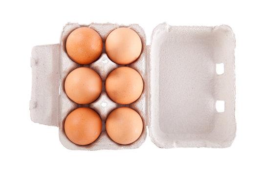Half dozen chicken eggs in box  isolated on white background.