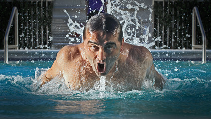 Swimmer is winning the race with butterfly stroke
