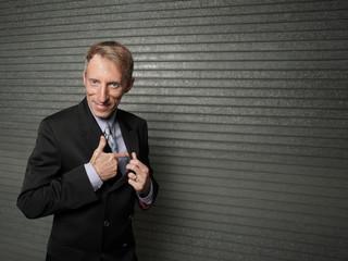 Businessman removing his hand gun