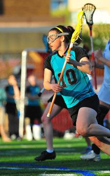 Lacrosse player running