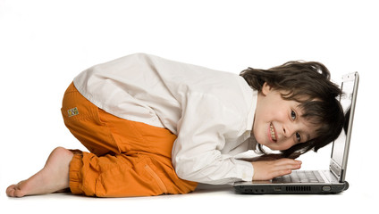 The merry boy with laptop on white background