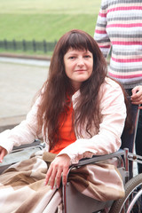 young woman on walk in an invalid carriage