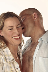 Man whispers in her ear