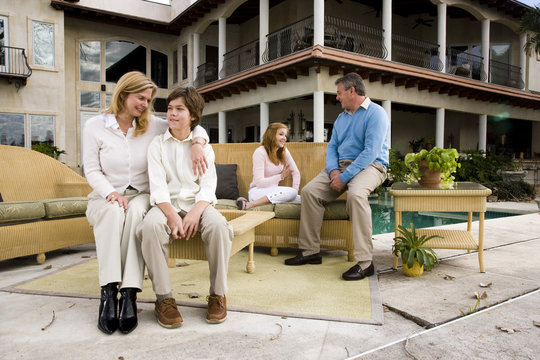 Family relaxing on patio together