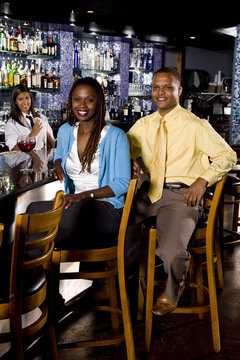 Young African couple sitting at a bar