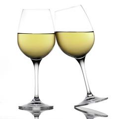 White wine glasses making a toast