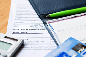 Open checkbook with credit cards and statement