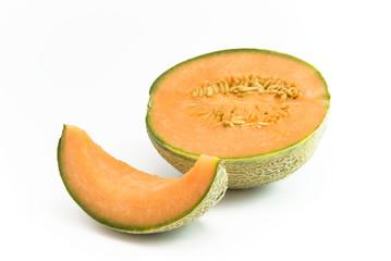 Melone halbiert und Stück