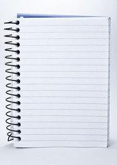 Notepad with spiral binding and white, lined pages.