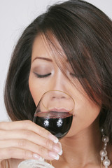woman drinking deeply of the wine