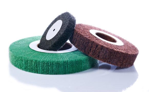 Three abrasive wheels