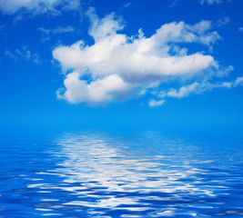 Blue sky with clouds on the water