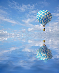 3d blue-white balloon in the blue sky and reflection in water