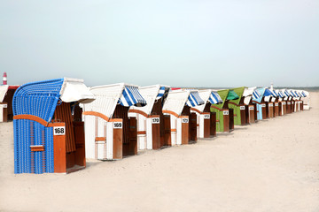 Row of Beach Huts in the Sand