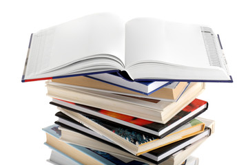 Open dictionary with blank pages on top of book stack isolated
