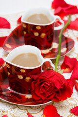 red cup of coffee with roses