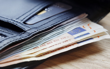Euro notes protruding from wallet