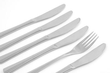 Vier Messer und eine Gabel