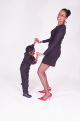 Mother and son dancing together