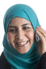 Muslim woman with a mobile phone