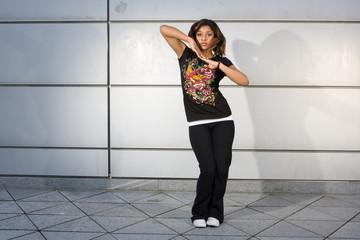 Young teenager dancing hip hop