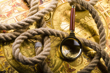 Map & Magnifying glass & Rope
