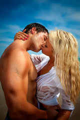Couple at the beach kissing