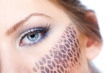 Close up on woman's eye and make up, isolate on white