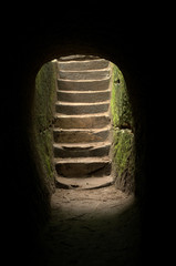 stairs on a cave opening