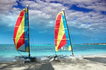 Two catamarans on a beach