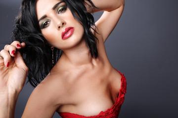 Brunette in red dress.
