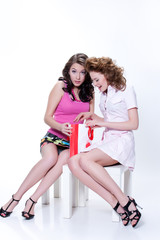 Young Emotional Women With Paper Bag