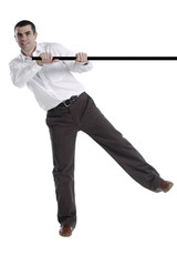 Isolated man swinging from black bar 1
