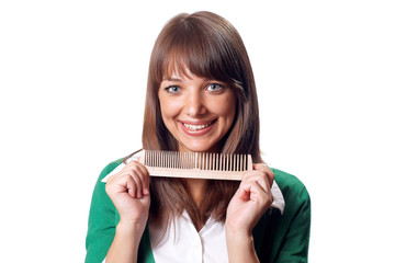 Beautiful office brunette woman with wood hairbrush