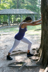 African american woman streatching before exercise