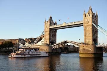 Replica of paddleboat passing through Tower Bridge, London