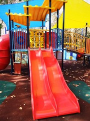 A picture of a colorful playground in park
