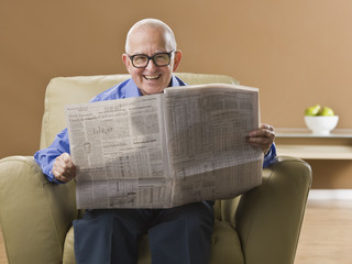 Elderly Man Reading Newspaper