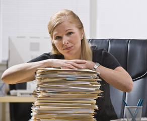 Woman with Stack of Files