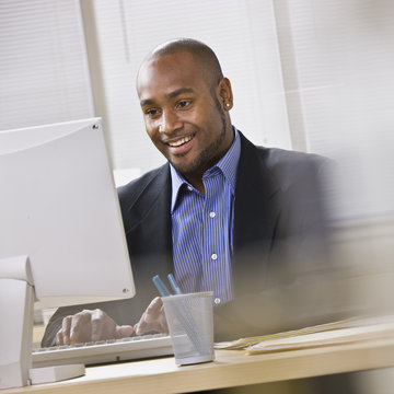 African American Businessman at computer.
