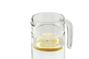 Glass jug with water and lemon