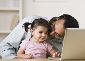Father And Daughter Playing on Computer