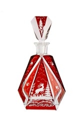 Red crystal carafe with cut prancing deer isolated