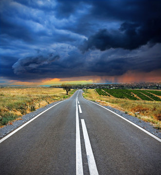 Colorful image of an empty road in stormy day