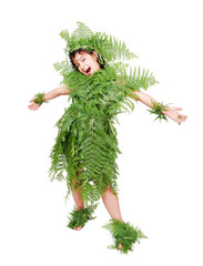 Pretty little girl dressed in green plant leafs