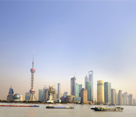 Wall Murals Shanghai Ships at sunset on the Huangpu River in Shanghai,China