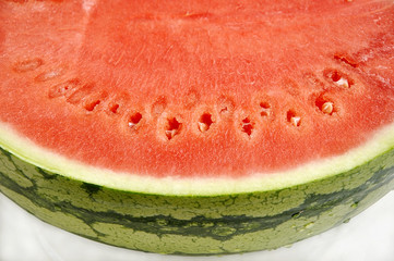Cut water melon on plate.