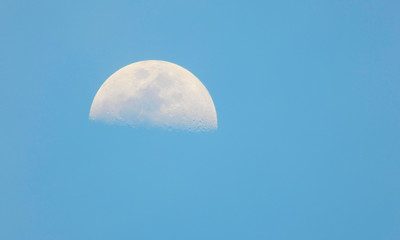 isolated moon in the blue sky