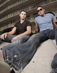 Two young men sitting on th ground