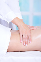 Beautician's hands doing back massage